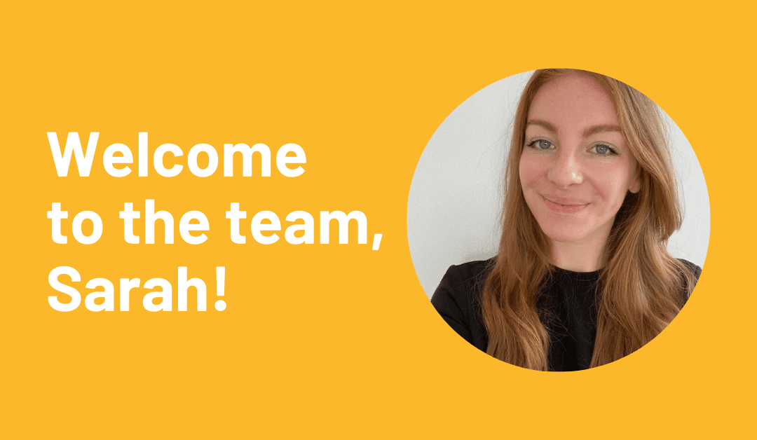 Welcome to the team, Sarah! [picture of Sarah, a young, red-haired white woman]